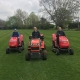 Three mowers on the village green